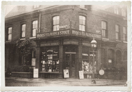 B&W photograph of a corner shop c.1940s